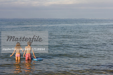 Brother and sister paddling in sea Stock Photo - Premium Royalty-Free, Image code: 649-07118654