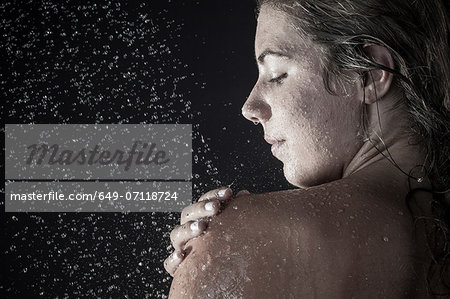 Woman showering Stock Photo - Premium Royalty-Free, Image code: 649-07118724