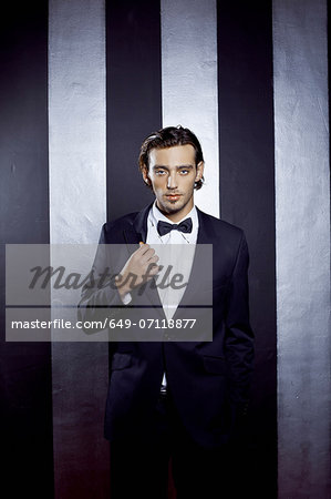 Portrait of young man wearing bow tie Stock Photo - Premium Royalty-Free, Image code: 649-07118877