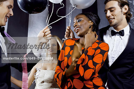 Young friends dancing in nightclub Stock Photo - Premium Royalty-Free, Image code: 649-07118884