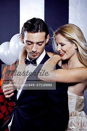 Young couple dancing together in nightclub Stock Photo - Premium Royalty-Free, Image code: 649-07118886