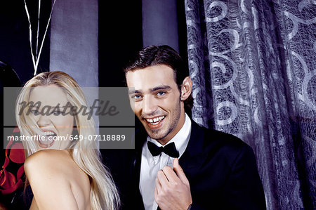 Young couple having fun in nightclub Stock Photo - Premium Royalty-Free, Image code: 649-07118889