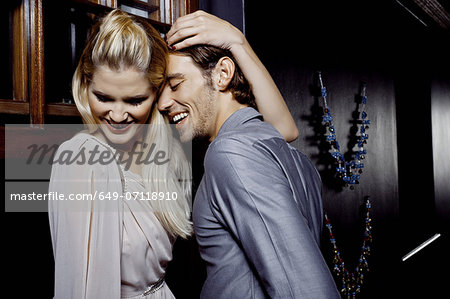 Young couple flirting in nightclub Stock Photo - Premium Royalty-Free, Image code: 649-07118910