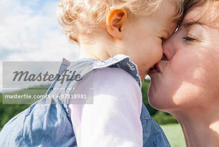 Mother kissing daughter Stock Photo - Premium Royalty-Free, Image code: 649-07118981