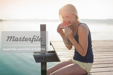 Portrait of young woman eating watermelon Stock Photo - Premium Royalty-Free, Image code: 649-07119050