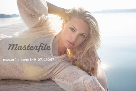 Close up of young woman posing on lake pier Stock Photo - Premium Royalty-Free, Image code: 649-07119057