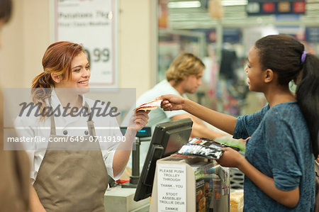 Female shop assistant handing bill to customer Stock Photo - Premium Royalty-Free, Image code: 649-07119190