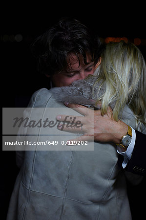 Mature couple comforting each other at night Stock Photo - Premium Royalty-Free, Image code: 649-07119202
