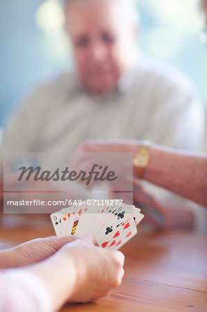 Senior male playing cards with family Stock Photo - Premium Royalty-Free, Image code: 649-07119277