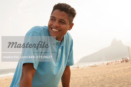Portrait of young man in Ipanema Beach, Rio de Janeiro, Brazil Stock Photo - Premium Royalty-Free, Image code: 649-07119627