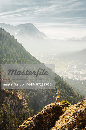 Man standing on mountain, Farchant, Bavaria, Germany Stock Photo - Premium Royalty-Free, Image code: 649-07119706