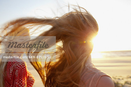 Mother and daughter on windy beach, close up Stock Photo - Premium Royalty-Free, Image code: 649-07119731
