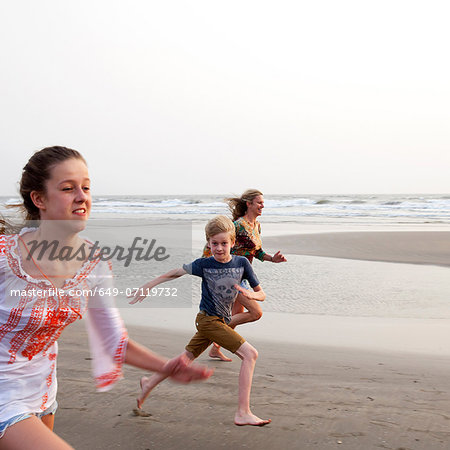 Mother, son and daughter running on beach Stock Photo - Premium Royalty-Free, Image code: 649-07119732