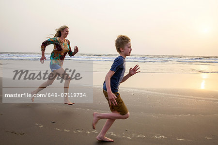 Mother and son running on beach Stock Photo - Premium Royalty-Free, Image code: 649-07119734