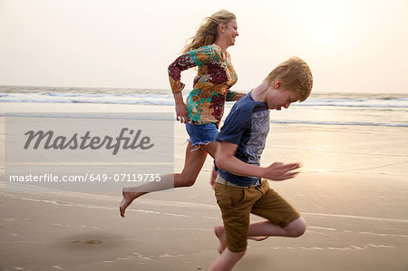 Mother and son running on beach Stock Photo - Premium Royalty-Free, Image code: 649-07119735