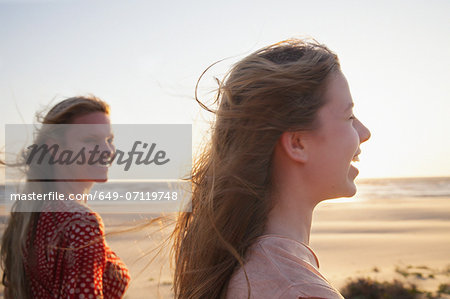 Mother and daughter on windy beach, close up Stock Photo - Premium Royalty-Free, Image code: 649-07119748