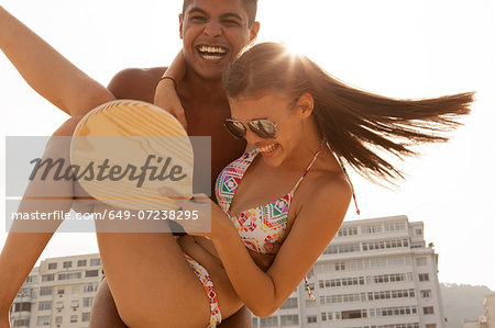 Young man swinging woman in arms Stock Photo - Premium Royalty-Free, Image code: 649-07238295
