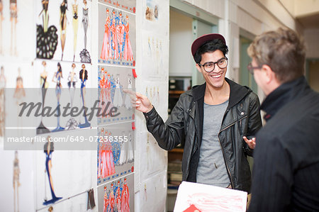 Fashion design teacher and student in discussion Stock Photo - Premium Royalty-Free, Image code: 649-07238355