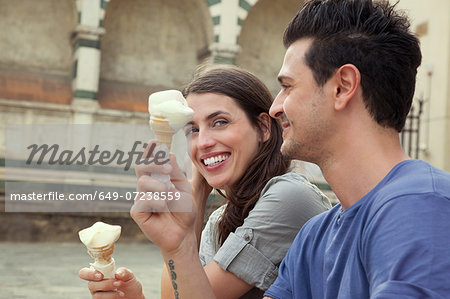 Couple eating ice creams, Santa Maria Novella square, Florence, Tuscany, Italy Stock Photo - Premium Royalty-Free, Image code: 649-07238559