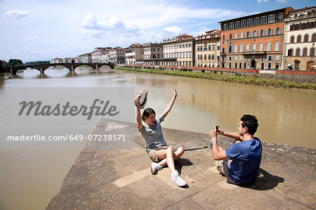 Man photographing woman with Ponte alle Grazie in background, Florence, Tuscany, Italy Stock Photo - Premium Royalty-Free, Image code: 649-07238571