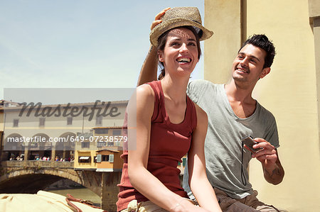 Man and woman by Ponte Vecchio, Florence, Tuscany, Italy Stock Photo - Premium Royalty-Free, Image code: 649-07238579