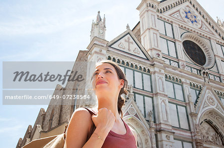 Woman outside Santa Croce church, Piazza di Santa Croce, Florence, Tuscany, Italy Stock Photo - Premium Royalty-Free, Image code: 649-07238584
