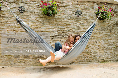 Portrait of mother and daughter in hammock Stock Photo - Premium Royalty-Free, Image code: 649-07238625
