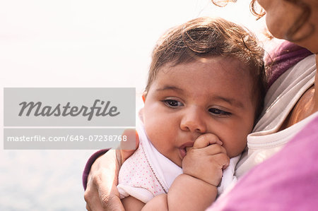 Mother cuddling baby girl Stock Photo - Premium Royalty-Free, Image code: 649-07238768