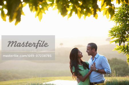 Couple in embrace Stock Photo - Premium Royalty-Free, Image code: 649-07238785