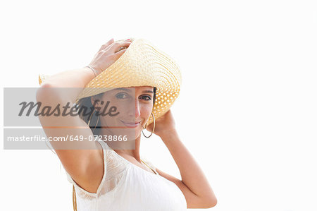 Woman posing for camera Stock Photo - Premium Royalty-Free, Image code: 649-07238866