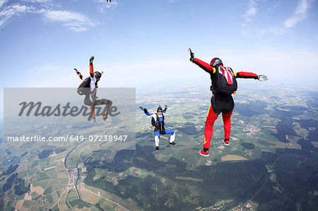 Three skydivers free falling above Leutkirch, Bavaria, Germany Stock Photo - Premium Royalty-Free, Image code: 649-07238947