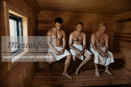 Three men sitting in sauna with heads bowed Stock Photo - Premium Royalty-Free, Image code: 649-07238960