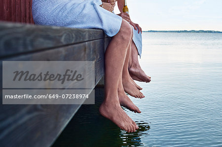 Close up of three males waist down outside sauna Stock Photo - Premium Royalty-Free, Image code: 649-07238974