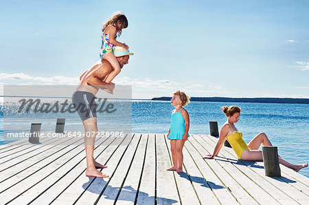 Parents and two young girls on pier, Utvalnas, Gavle, Sweden Stock Photo - Premium Royalty-Free, Image code: 649-07238986