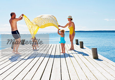 Parents and two young girls playing on pier, Utvalnas, Gavle, Sweden Stock Photo - Premium Royalty-Free, Image code: 649-07238987