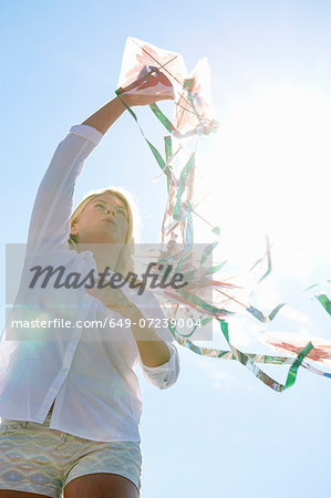 Young woman holding kite, Utvalnas, Gavle, Sweden Stock Photo - Premium Royalty-Free, Image code: 649-07239004