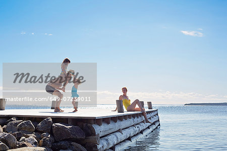 Young family on pier, Utvalnas, Gavle, Sweden