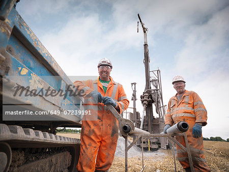 Portrait of drilling rig workers in hard hats and workwear Stock Photo - Premium Royalty-Free, Image code: 649-07239191