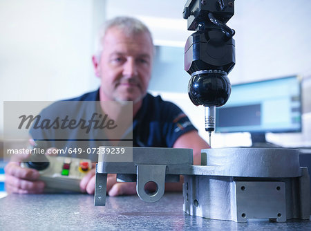 Engineer measuring components in factory Stock Photo - Premium Royalty-Free, Image code: 649-07239239