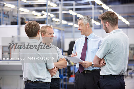 Workers and manager meeting in engineering warehouse Stock Photo - Premium Royalty-Free, Image code: 649-07239346