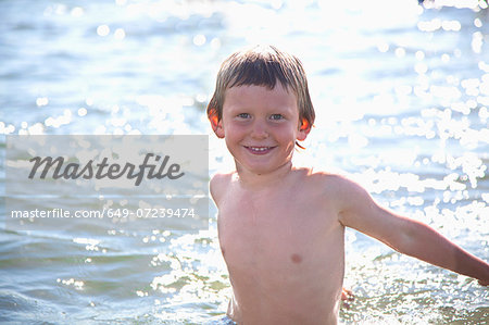 Portrait of boy in water, Wales, UK Stock Photo - Premium Royalty-Free, Image code: 649-07239474