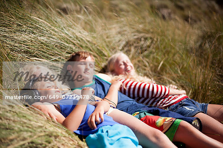 Four friends relaxing in dunes, Wales, UK Stock Photo - Premium Royalty-Free, Image code: 649-07239478