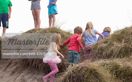 Group of friends on dunes, Wales, UK Stock Photo - Premium Royalty-Free, Image code: 649-07239487