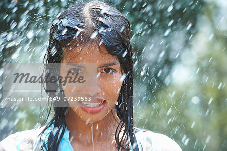 Portrait of young woman in rain Stock Photo - Premium Royalty-Free, Image code: 649-07239563