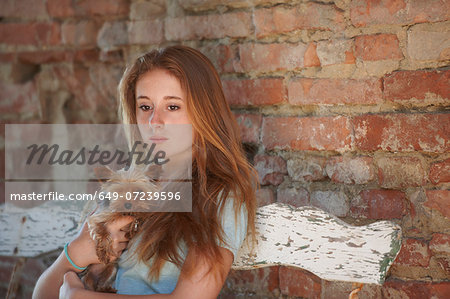 Teenage girl on bench with dog Stock Photo - Premium Royalty-Free, Image code: 649-07239596