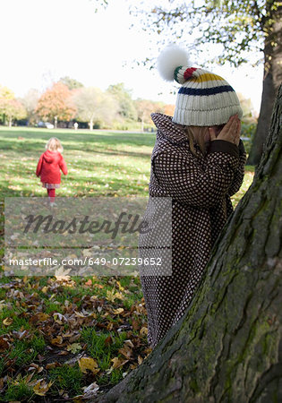 Girls playing hide and seek in park, London, England, UK Stock Photo - Premium Royalty-Free, Image code: 649-07239652