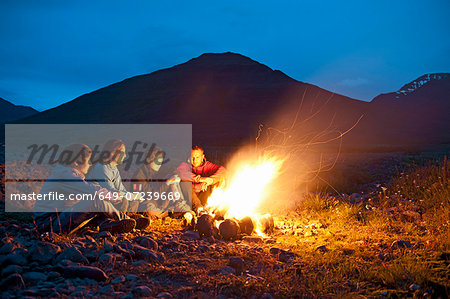 Group sitting at campfire, Eyjafjordur, North Iceland Stock Photo - Premium Royalty-Free, Image code: 649-07239669