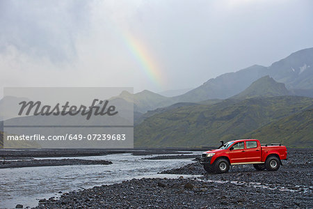 Customised SUV waiting to cross the glacial river Krossa, Thorsmork, Iceland Stock Photo - Premium Royalty-Free, Image code: 649-07239683