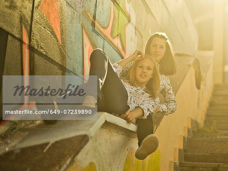 Two young women reclining on stairway Stock Photo - Premium Royalty-Free, Image code: 649-07239890