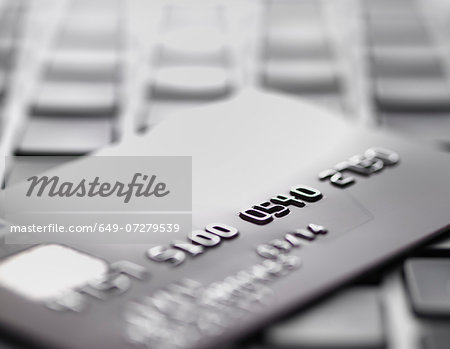 Credit card on laptop to illustrate internet shopping and internet fraud Stock Photo - Premium Royalty-Free, Image code: 649-07279539